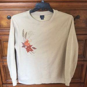 Tan sweatshirt with leaves